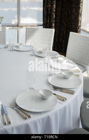 Event white restaurant table served and wait for guests. - Stock Photo