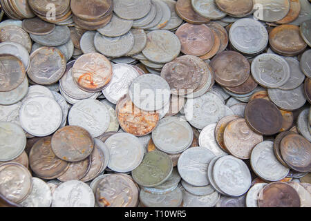 Soviet coins sprinkled on the whole frame of the photo. The USSR ruble. Old coins for numismatics - Stock Photo