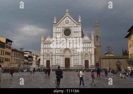 Italy, Florence - April 02 2017: the front view of Basilica Santa Croce facade with rainy clouds on background on April 02 2017, Tuscany, Italy. - Stock Photo
