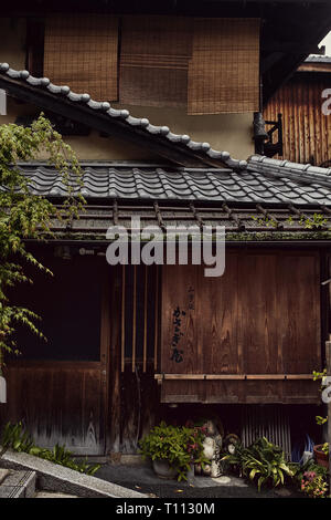 Traditional architecture and design in a neighborhood in Kyoto, Japan. - Stock Photo