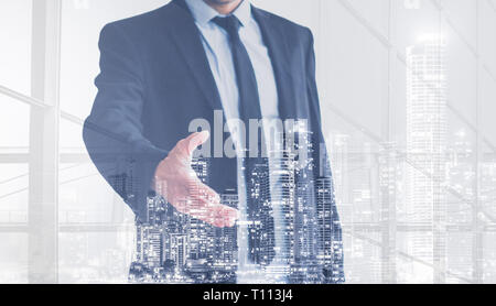 real estate business man  offering hand for handshake , city skyline double exposure - Stock Photo