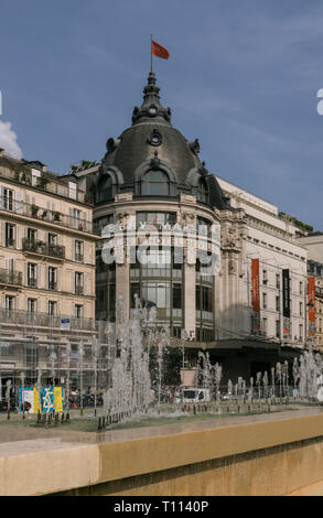 Autumn sunshine lights the bazar de l'hotel de ville department store in the centre of Paris, France - Stock Photo