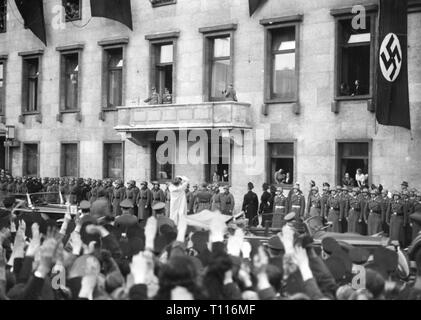 Nazism / National Socialism, politics, Annexation of Austria, 1938, Reich Chancellor Adolf Hitler on the balcony of the Chancellery after his return from Vienna, Berlin, March 1938, Anschluss, Herrmann Göring, crowd, crowds, crowds of people, Wilhelmstrasse, Greater German Realm, Greater Germany, Grossdeutsches Reich, Germany, German Reich, Third Reich, 20th century, 1930s, politics, policy, connection, connexion, connections, connexions, Chancellor of the Reich, Reichskanzler, balcony, balconies, historic, historical, Additional-Rights-Clearance-Info-Not-Available - Stock Photo