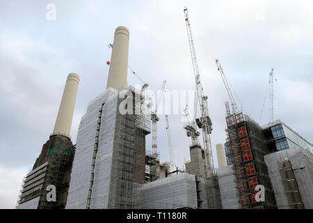 A low angle view of Battersea Power Station under construction during redevelopment & cranes in Wandsworth South London SW8 England UK  KATHY DEWITT - Stock Photo