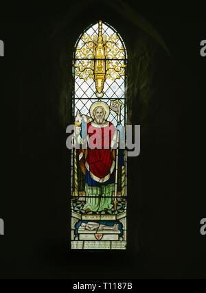 C20th memorial window to Rev. William Jones above vestry of St Garmon's Church, Llanarmon-yn-Iâl, Denbighshire, Wales, showing St Germanus of Auxerre. - Stock Photo