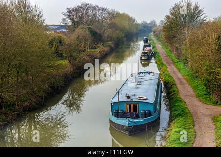 Narrowboats moored up on the Kennet and Avon Canal outside Hilperton in Wiltshire - Stock Photo