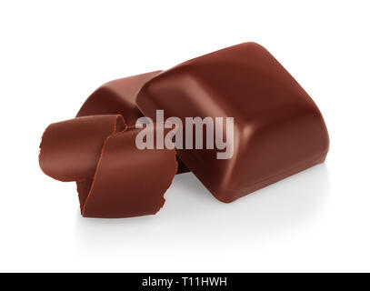 Chocolate pieces with chocolate shavings on white background - Stock Photo