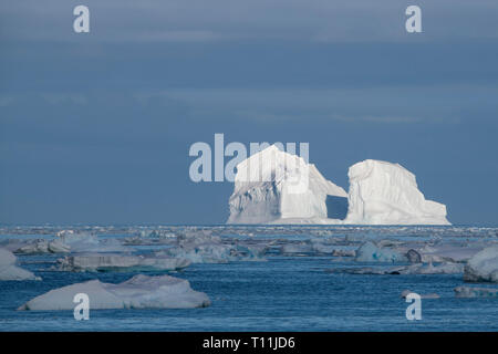 Antarctica, below the Antarctic Circle. Ice filled bay in the Bellingshausen Sea in Crystal Sound. - Stock Photo
