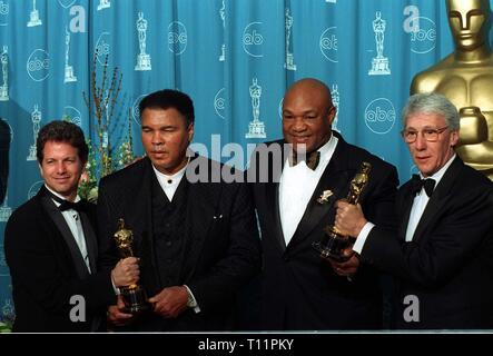 LOS ANGELES, CA. March 25, 1997: Muhammad Ali (Left) & George Foreman with the makers of  the documentary 'When They Were Kings,' at the Academy Awards. Pix: Paul Smith - Stock Photo