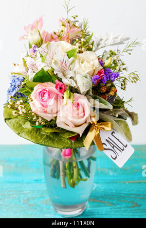 Photo of romantic bouquet of pink roses, lilies, green leaves - Stock Photo