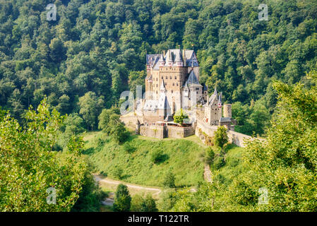 Panoramic view of the unscathed medieval Eltz castle on a rock in a valley surrounded by a nature reserve forest, Rhineland-Palatinate, Germany - Stock Photo