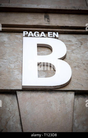 Payment in B (black money) in Spanish (tax offense without VAT, without taxes) - Stock Photo