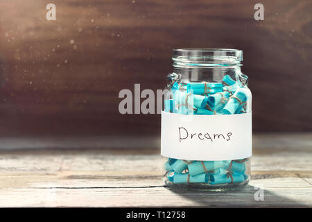 Dreams jar concept. Full glass jar of cherished wishes - Stock Photo
