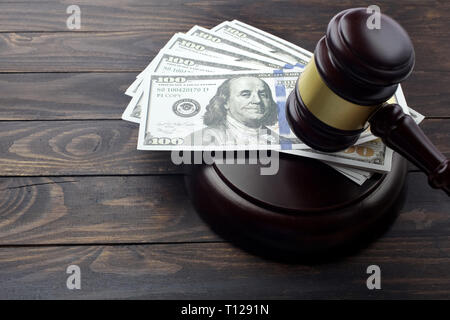 judge gavel and money on brown wooden table concept - Stock Photo