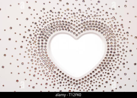 The shape of white heart with crystals around as shiny diamonds - Stock Photo