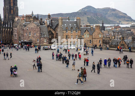 Visitors at Edinburgh castle with Arthurs seat in the distance,Edinburgh,Scotland,UK - Stock Photo