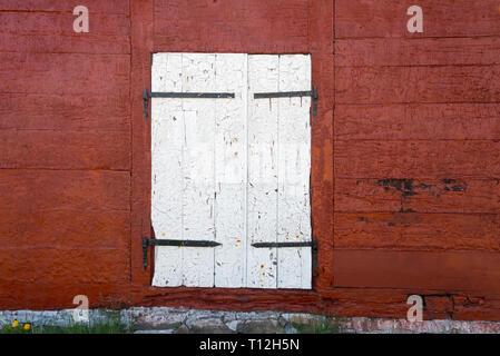 Paint on old warehouse door peeling, Sisimiut, Greenland - Stock Photo