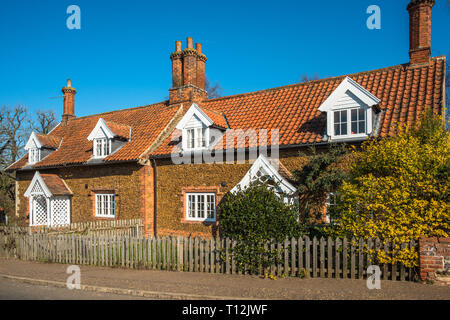 Characterful cottages in the village of Castle Rising in Norfolk, East Anglia, England, UK. - Stock Photo