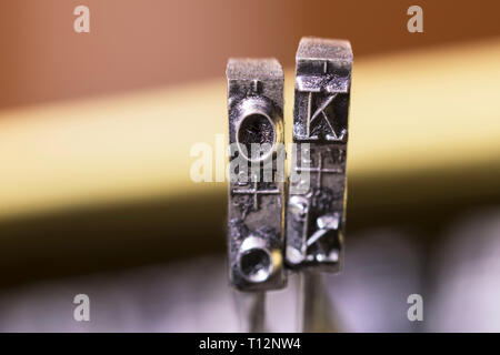 Macrophotography of typewriter hammers with OK word