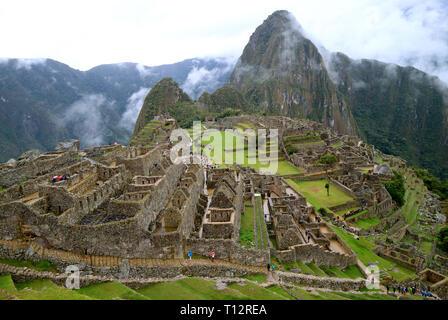 Machu Picchu Archaeological site, the Mysterious Inca Fortress Ruins in the Rain, Cusco Region, Peru, South America - Stock Photo