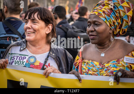 Women are seen holding a banner during the demonstration. Thousands of people have marched in Barcelona against fascism and racism. Supported by some 200 social organizations, trade unions and parties, framed in the International Day against Racism, the protest has been focused mainly against the new party of the Spanish right wing VOX already with parliamentary representation. - Stock Photo