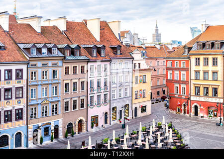 Warsaw, Poland - August 22, 2018: Historic cityscape with view of colorful architecture buildings in old town market square in morning - Stock Photo
