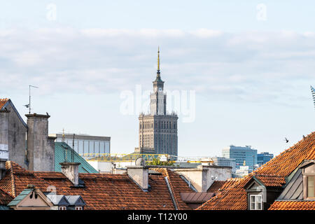 Warsaw, Poland - August 22, 2018: Downtown modern cityscape with Palace of Culture and Sciences building skyscraper and old town rooftop houses - Stock Photo