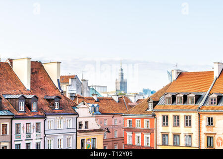 Warsaw, Poland - August 22, 2018: Downtown cityscape with Palace of Culture and Sciences building skyscraper and multicolored old town rooftop houses - Stock Photo