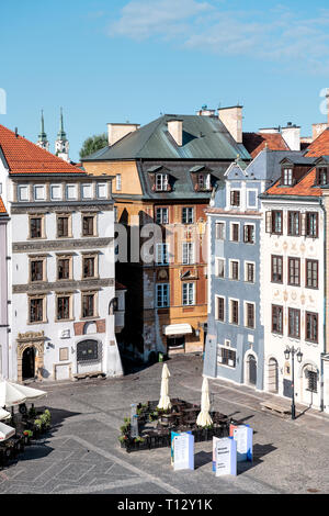 Warsaw, Poland - August 22, 2018: Historic vertical cityscape with view of colorful architecture buildings in old town market square in morning - Stock Photo