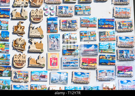 Warsaw, Poland - August 22, 2018: Many souvenirs colorful vibrant colors magnets for refrigerator on display in shopping street market - Stock Photo