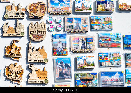 Warsaw, Poland - August 22, 2018: Many souvenirs colorful vibrant colors images magnets for refrigerator on display in shopping street market - Stock Photo