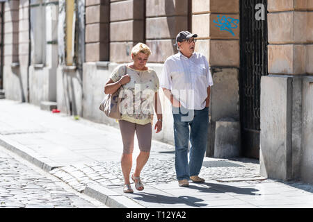 Warsaw, Poland - August 22, 2018: Old town cobblestone street people tourists walking on sidewalk summer day cobbled road - Stock Photo