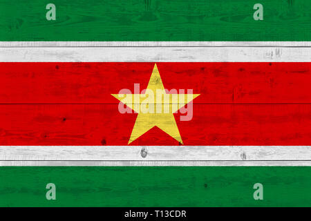Suriname flag painted on old wood plank. Patriotic background. National flag of Suriname - Stock Photo