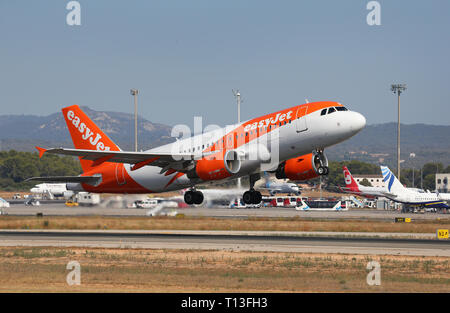 An Easyjet company Airliner taking off from palma de mallorca airport, one of main destinations for european tourists during summer - Stock Photo