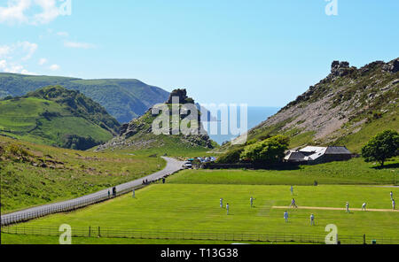 Men playing cricket in the Valley of the Rocks, near Lynton and Lynmouth, Devon, UK - Stock Photo