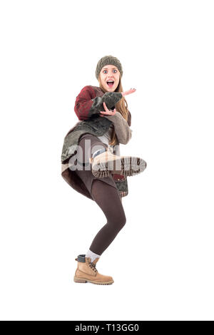 Cool funky playful comic girl kicking leg in karate style. Full body isolated on white background. - Stock Photo
