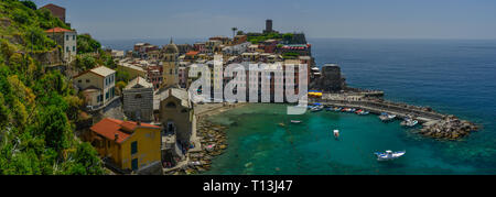 A panorama of Vernazza, one of the five towns that comprise Cinque Terre on the Ligurian coast of Italy. This elevated view looks over the village. - Stock Photo