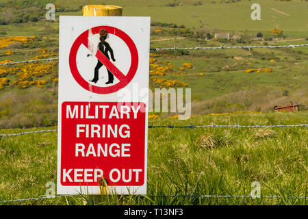 Sign: Military firing range keep out, seen on the South West Coast Path between Worbarrow Bay and Brandy Bay, Jurassic Coast, Dorset, UK - Stock Photo