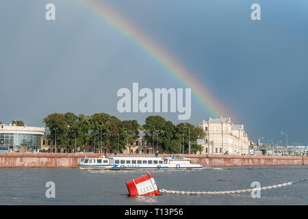 Saint Petersburg, Russia, August 22: View of the evening rainbow in Pitere over the Neva River, from the parking lot of the legendary cruiser Aurora,  - Stock Photo