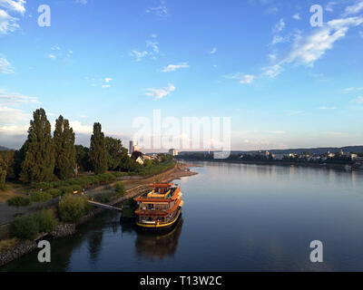 Aerial view of Rhein river against cityscape of Bonn - Stock Photo