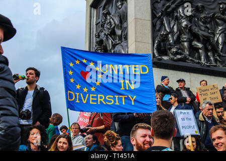 London, UK. 23rd Mar, 2019. People's Vote March, activists and demonstrators take part in a march to parliament, protesting against Britain leaving the EU, wanting a second referendum, and for the country to remain in the union. - Stock Photo
