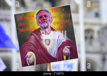 London, UK.  23 March 2019. A sign depicting Labour leader Jeremy Corbyn as the Messiah is held aloft as thousands of people take part in a rally in Parliament Square after the 'Put It To The People March', on what was supposed to be six days before the UK was due to leave the EU, before an extension to the departure date was given.  Protesters demand that the public is given a final say on Brexit as support for the Prime Minister's withdrawal plan continues to recede.  Credit: Stephen Chung / Alamy Live News - Stock Photo