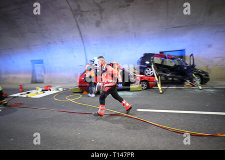 Suhl, Germany. 23rd Mar, 2019. In the Berg Bock tunnel of the 71 autobahn, rescue workers provide actors who mime injured people. During the large-scale exercise with around 600 participants from the fire brigade, rescue service, ambulance and care trains and the police, the rescue, rescue and care of many injured persons after a serious traffic accident in the tunnel is practiced. Credit: Bodo Schackow/dpa-Zentralbild/ZB/dpa/Alamy Live News