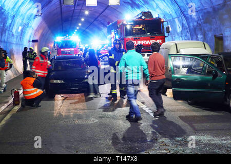 Suhl, Germany. 23rd Mar, 2019. In the Berg Bock tunnel of the 71 autobahn, rescue workers perform an exercise with actors who mimic the injured. During the large-scale exercise with around 600 participants from the fire brigade, rescue service, ambulance and care trains and the police, the rescue, rescue and care of many injured persons after a serious traffic accident in the tunnel is practiced. Credit: Bodo Schackow/dpa-Zentralbild/ZB/dpa/Alamy Live News