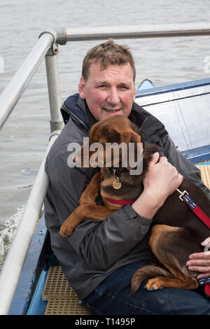 London, UK. 23rd Mar, 2019. 23 March 2019. Boat Race Fixture. OUWBC vs Molesey BC. Pictured:- Umpire Sir Matthew Pinsent CBE aboard the Umpire's launch with his dog. As preparation for the The Boat Races, Oxford and Cambridge clubs participate in a number of Fixtures against other clubs, rowing the same Tideway course as used for the Boat Race. OUWBC Crew List (Yellow hulled boat):- Stroke: Amelia Standing, 7. Tina Christmann, 6. Beth Bridgman, 5. Liv Pryer, 4. Lizzie Polgreen, 3. Renée Koolschijn, 2. Anna Murgatroyd, Bow. Issy Dodds, Cox. Eleanor Shearer, Credit: Duncan Grove/Alamy Live News - Stock Photo
