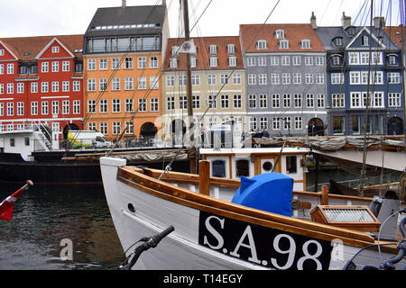 Copenhagen / Denmark - August 18 2018: Boat tied to Nyhavn and colourful houses at the background