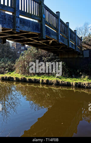 Footbridge over the Grand Union Canal with reflection, Northolt, Middlesex - Stock Photo