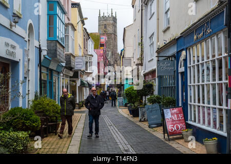 Tourists and locals wandering along Foss Street in Dartmouth, Devon, UK - Stock Photo