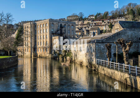 The Old Mill, now apartments, on the side of the River Avon at Bradford on Avon in West Wiltshire. Bradford on Avon grew rich from the wool trade. - Stock Photo