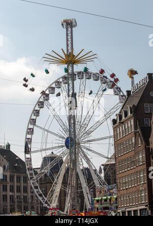 AMSTERDAM, NETHERLANDS - APRIL 20, 2017: big wheel on Koninginnedag Dam Square in Amsterdam Netherlands - Stock Photo